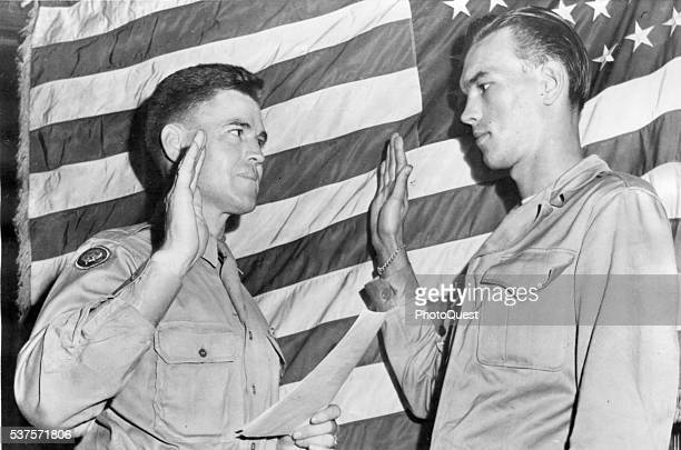 Lt Col Joseph C Chedister swears Edward C Keith Jr into the regular Army Indianapolis Indiana August 27 1945 Keith had been on the infamous 'Death...