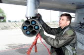 Lt Col Mark Koechle A10 Thunderbolt Ii Pilot And 81St Fighter Squadron Commander Conducts A PreFlight Inspection In This Undated Photo In Kuchyna...