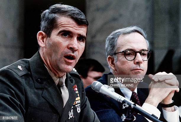 Lt Col Oliver North accompanied by his lawyer Brendan Sullivan as he testifies before IranContra investigators 14 July 1987 Washington DC It was...