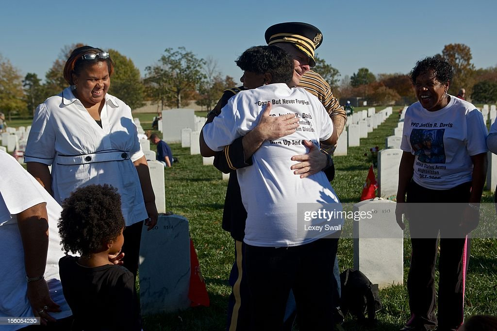 Lt. Col. Thomas Helms, the senior Army Chaplain at Arlington National Cemetery, hugs Paula Davis, the mother of Pfc. Justin Davis, who died in Afghanistan when he was 19 years old on Veteran's Day at Arlington National Cemetery on November 11, 2012 in Arlington, Virginia. Numerous events are under across the country to honor the nation's current and former service members.