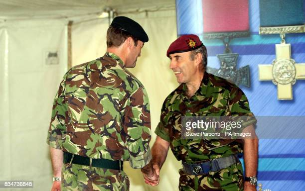 Lt Colonel Patrick Sanders OBE of the Rifles Regiment receives congratulations from Lt General Graeme Lamb on his award of an Distinguished Service...