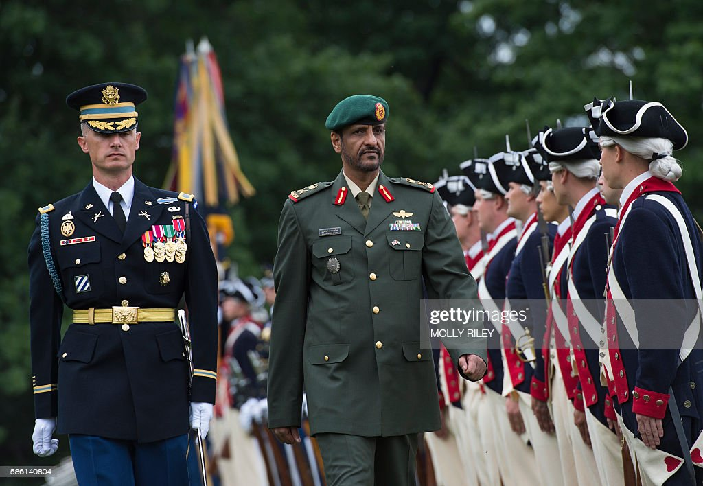 Lt Gen Hamad Mohamed Thani Al Rumaithy United Arab Emirates Armed Forces chief of stafftakes part in a troop inspection with Col Jason T Garkey...