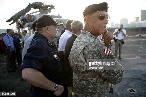 Lt Gen Russel Honor right waits for President Bush to arrive aboard the USS Iwo Jima in New Orleans Louisiana September 15 2005 Honore a Louisiana...
