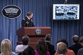 Lt Gen William C Mayville Jr Joint Staff Director of Operations Director of Operations shows before and after images of airstrikes in Syria during a...