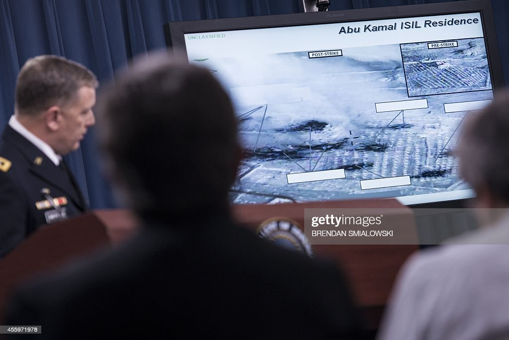 Lt Gen William C Mayville Jr Joint Staff Director of Operations Director of Operations shows before and after photos as he speaks on the airstrikes...