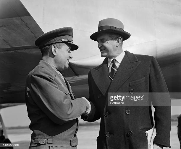 Lt General Curtis E LeMay organizer of Berlin's famed 'Operation Vittles' is shown receiving congratulations from Air Secretary W Stuart Symington as...