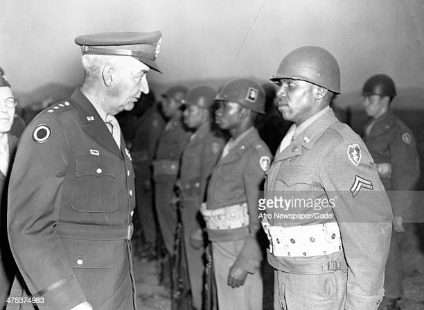 Lt General R L Eichelberger US Eight Army talks to a Cpl of the 24th Infantry Regiment 25th Infantry Division at Camp Majestic Gifu Japan April 10...