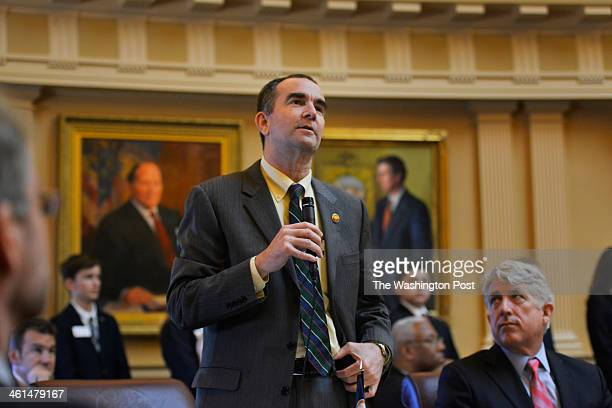 Lt Governorelect Ralph Northam addresses the senate floor as Attorney Generalelect Mark Herring listens as Virginia's General Assembly reconvenes...