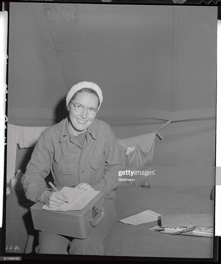Lt Jean Williams of Washington DC shows a happy face to Sam Goldstein INPPool Photographer as he asks her to pose while she was writing a letter to...