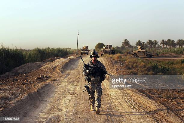 Lt John Busch of Baytown Texas with the 3rd Armored Cavalry Regiment walks on a patrol on July 13 2011 in Iskandariya Babil Province Iraq As the...