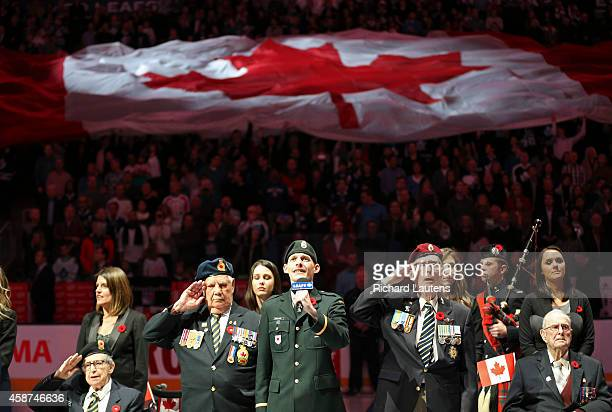 Lt Scott Newlands is all smiles as he finishes the national anthem surrounded by Canadian veterans The Leafs had a remembrance day ceremony before...