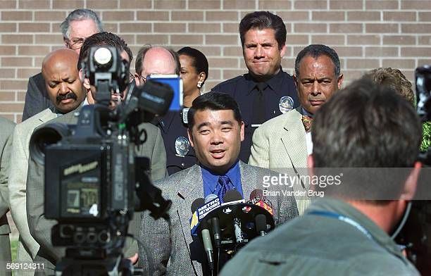 Lt Terry Hara center one of several officials gathered speaks at a press conference held outside Devonshire Division police station Thursday...