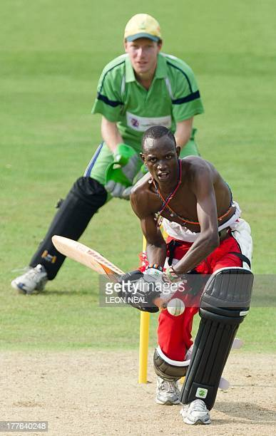 Ltemulai Daniel Mamai of the Maasai Warrior cricket team hits a shot during a friendly match against the Charity VIII team during opening ceremony...
