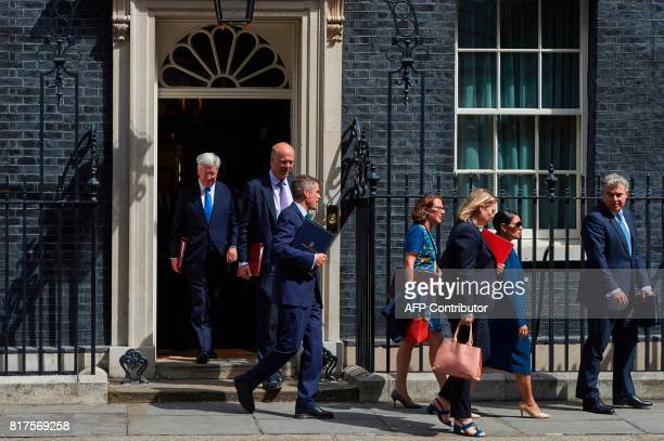 Britain's Defence Secretary Michael Fallon Britain's Transport Secretary Chris Grayling Britain's Parliamentary Secretary to the Treasury and Chief...