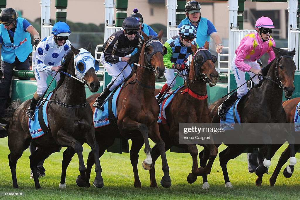 LtoR, Luke Nolen riding Oregan Spirit, Steven Arnold riding Mr O'ceirin, Dean Yendall riding Constant Force and Jordan Childs riding Kuitpo Lad jump out of the barriers in the Dominant Handicap during Melbourne Racing at Moonee Valley Racecourse on June 29, 2013 in Melbourne, Australia.