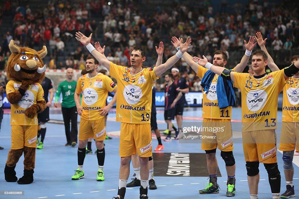 LtoR Michal Jurecki Mateusz Kus and Julen Ahuinagalde Akizu of Kielce celebrate after the first semifinal of the EHF Final4 between VS Tauron Kielce...