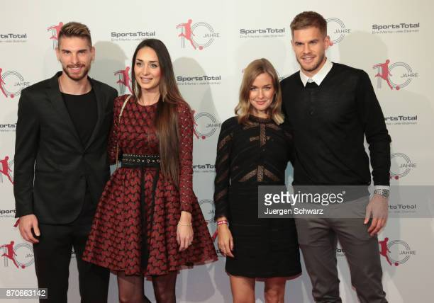 LtoR Ron Robert Zieler with Anna Laura and Simon Terodde pose at the 10th anniversary celebration of the Sports Total Agency on November 5 2017 in...
