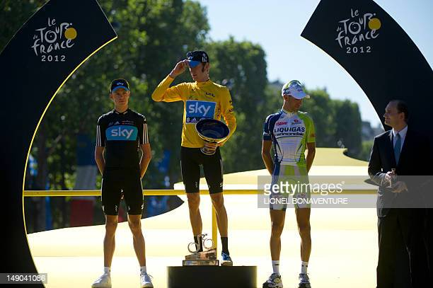 LtoR Secondplaced in the overalls Great Britain's Christopher Froome Overall leader's yellow jersey British Bradley Wiggins and thirdplaced Italy's...