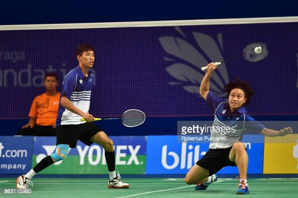 Lu Chen and Lin Jhih Yun of Chinese Taipei compete against Rehan Naufal Kusharjanto and Siti Fadia Silva Ramadhanti of Indonesia during Mixed Doubles...