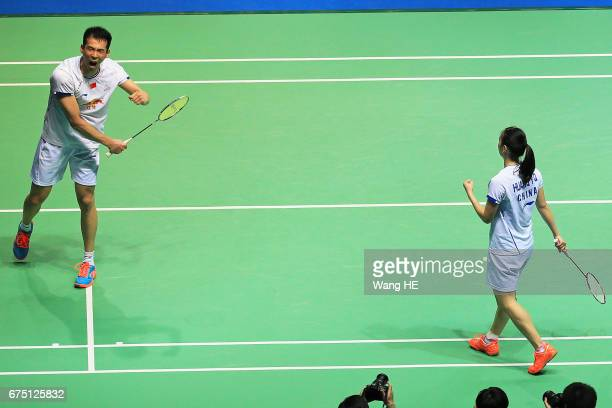 Lu Kai and Huang Yaqiong celebrates after defeating Sapslewiree Taerattan and Dechapol Puavaranukroh of Thailand during mixed doubles final match at...