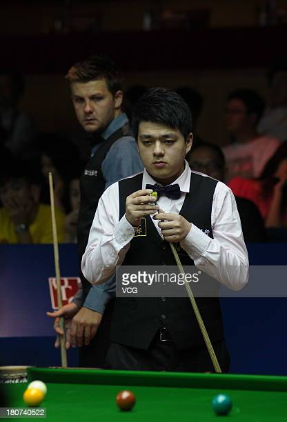 Lu Ning of China looks on in the match against Ryan Day of Wales on day 1 of the 2013 World Snooker Shanghai Masters at Shanghai Grand Stage on...