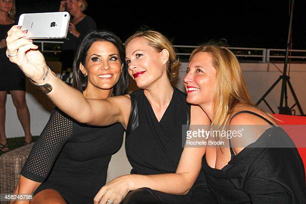 Lu Parker Michelle Vink and Jaclyne Brander attend The Art of Elysium Private Fundraiser Art Auction hosted by Board Member Christopher R King on...