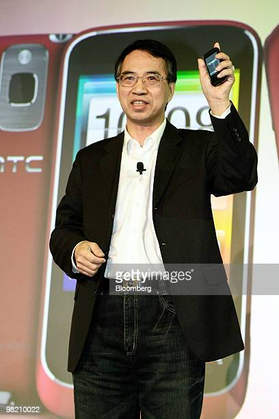 Lu Shyueching chairman of Chunghwa Telecome Co holds the HTC Smart smartphone during the unveiling in Taipei Taiwan on Friday April 2 2010 HTC Corp...