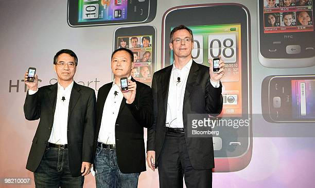 Lu Shyueching chairman of Chunghwa Telecome Co left Peter Chou president and chief executive officer of HTC Corp center and Paul Jacobs chief...