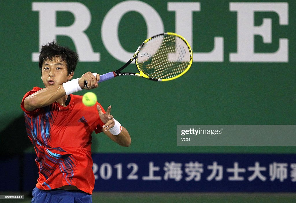 Lu Yen-hsun Chinese Taiwan returns a ball toZhang Ze of China during day three of the Shanghai Rolex Masters at the Qi Zhong Tennis Center on October 9, 2012 in Shanghai, China.