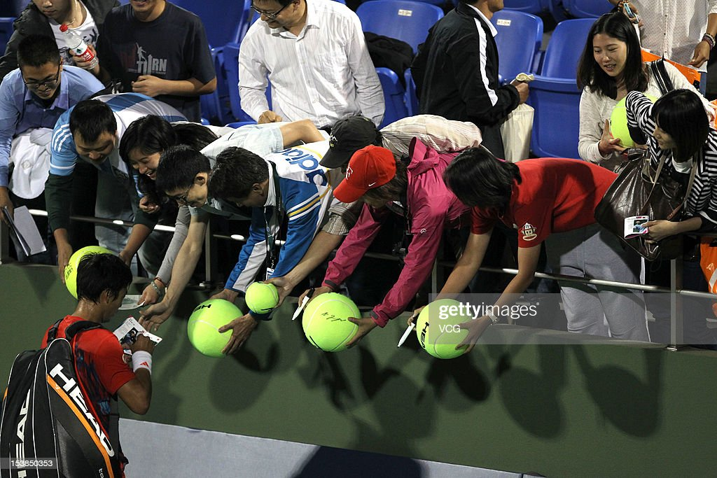Lu Yen-hsun Chinese Taiwan signs for fans after match against Zhang Ze of China during day three of the Shanghai Rolex Masters at the Qi Zhong Tennis Center on October 9, 2012 in Shanghai, China.