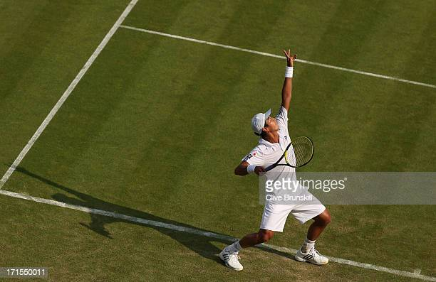 Lu YenHsun of Taipei serves during his Gentlemen's Singles second round match against Andy Murray of Great Britain on day three of the Wimbledon Lawn...