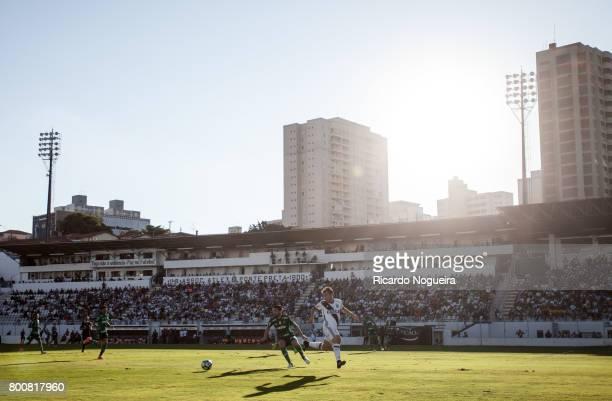 Luan Garcia of Palmeiras battles for the ball with Renato Caja of Ponte Preta during the match between Ponte Preta and Palmeiras as a part of...