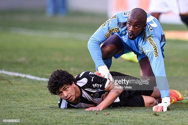 Luan of Atletico MG and Andrey of Botafogo battle for the ball during a match between Atletico MG and Botafogo as part of Brasileirao Series A 2014...