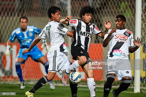 Luan of Atletico MG and Elton and Rodinei of Ponte Preta battle for the ball during a match between Atletico MG and Ponte Preta as part of...