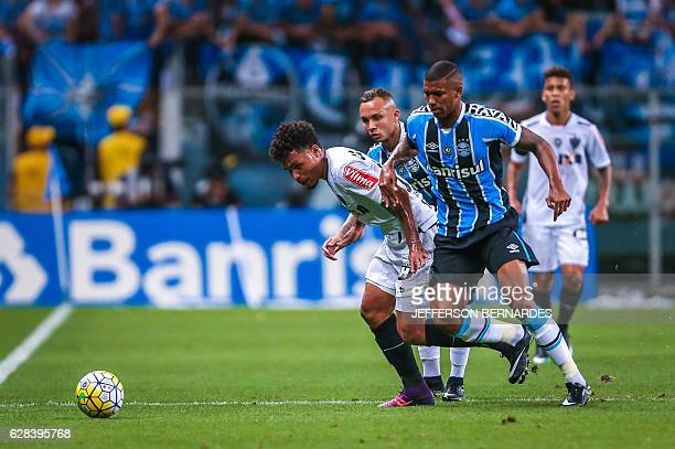 Luan of Atletico Mineiro and Walace of Gremio battle for the ball during the 2016 Brazil Cup final match at the Arena do Gremio stadium on December...