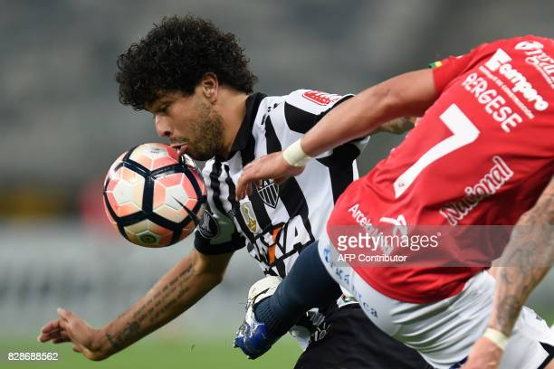 Luan of Brazil's Atletico Mineiro vies for the ball with Marcelo Bergese of Bolivia's Jorge Wilstermann during their 2017 Copa Libertadores match...