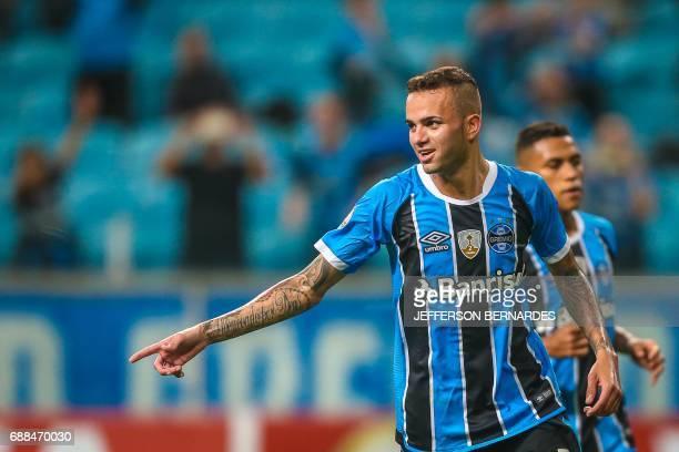 Luan of Brazil's Gremio celebrates after scoring against Venezuela's Zamora during their Copa Libertadores football match at the Arena do Gremio...