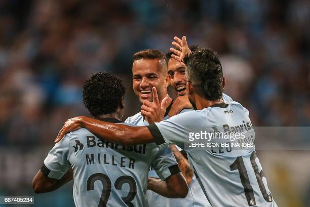 Luan of Brazil's Gremio celebrates with teammates after scoring against Chile's Deportes Iquique during their Copa Libertadores 2017 football match...