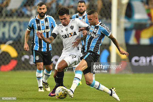 Luan of Gremio and Junior Urso of Atletico MG battle for the ball during a match between Gremio and Atletico MG as part of Copa do Brasil Final 2016...