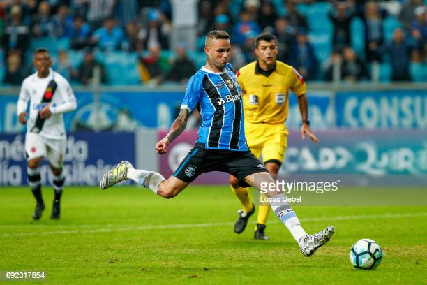 Luan of Gremio battles for the ball against Breno of Vasco during the match Gremio v Vasco as part of Brasileirao Series A 2017 at Arena do Gremio on...