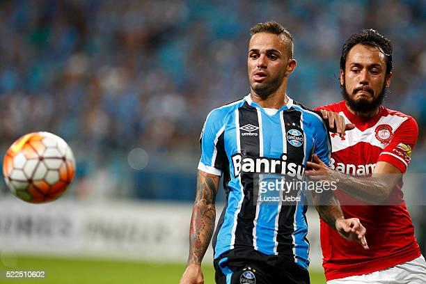 Luan of Gremio battles for the ball against Gerardo Flores of Toluca during the match Gremio v Toluca as part of Copa Bridgestone Libertadores 2016...