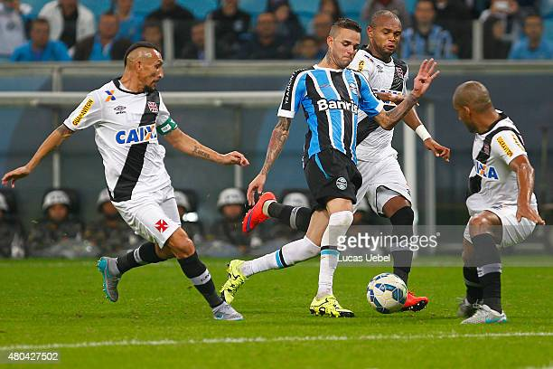 Luan of Gremio battles for the ball against Madson of Vasco during the match between Gremio and Vasco as part of Brasileirao Series A 2015 at Arena...