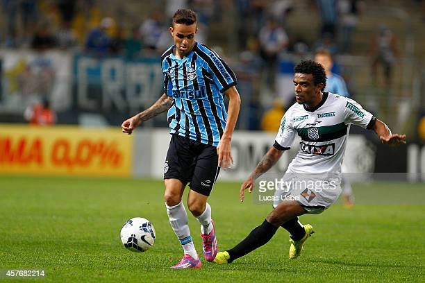 Luan of Gremio battles for the ball against Paulo Roberto of Figueirense during the match Gremio v Figueirense as part of Brasileirao Series A 2014...