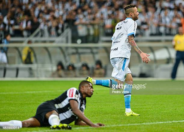 Luan of Gremio celebrates scoring a goal against Atletico MG during a match between Atletico MG and Gremio as part of Brasileirao Series A 2015 at...