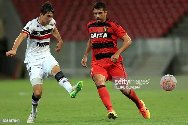 Luan Peres of Brazilian Santa Cruz vies for the ball with Diego Souza of Brazilian Sport Recife during a Sudamericana Cup football match in Recife...