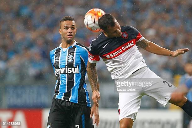 Luan player of Gremio battles for the ball against Emmanuel Mas of San Lorenzo during the match Gremio v San Lorenzo as part of Copa Bridgestone...