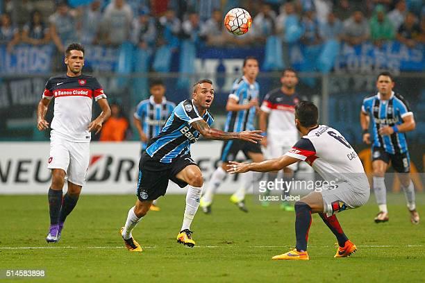 Luan player of Gremio battles for the ball against Matias Caruzzo during the match Gremio v San Lorenzo as part of Copa Bridgestone Libertadores 2016...