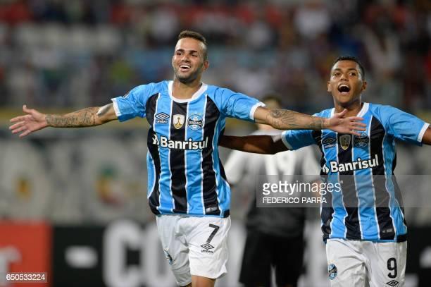 Luan Vieira of Brazil's Gremio celebrates with teammates after scoring against Venezuela's Zamora during their Copa Libertadores 2017 football match...