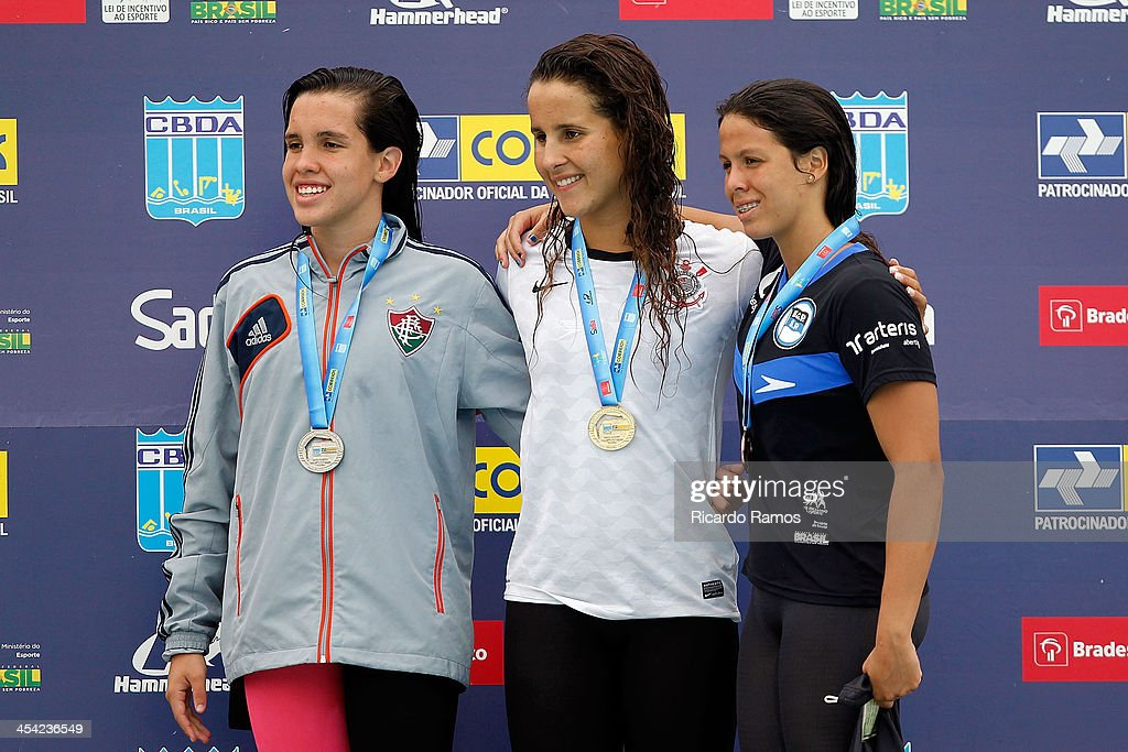 Luana Ribeiro, Natalia de Lucas and Thais dos Santos Resende stands on the podium for girls 50m freestyle Junior 1 during Julio Delamare Trophy at Botafogo Aquatic Park on December 07, 2013 in Rio de Janeiro, Brazil.