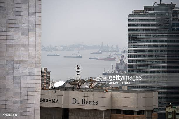 Luanda's harbour is seen between buildings on July 3 2015 in Luanda AFP PHOTO/ ALAIN JOCARD